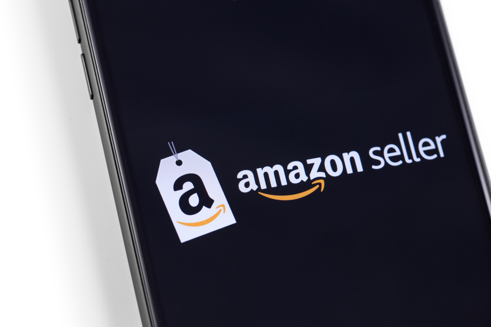 Masteradz   A phone with amazon seller's logo on a black screen with a white background